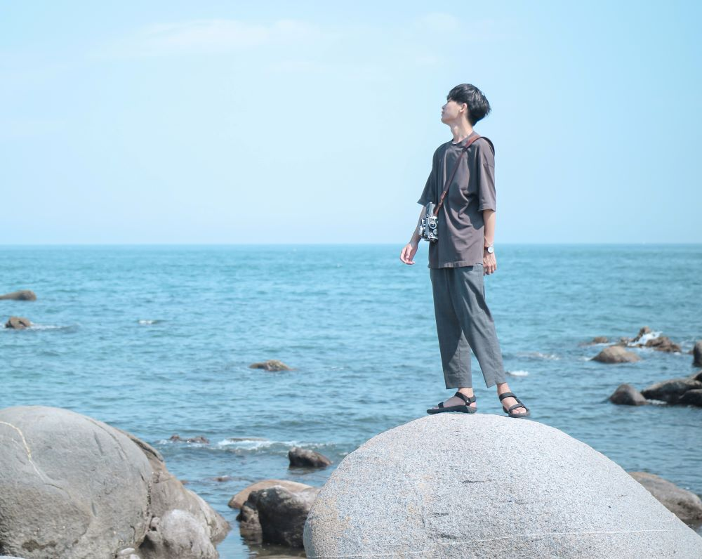 Japanese tourist looking out on the sea